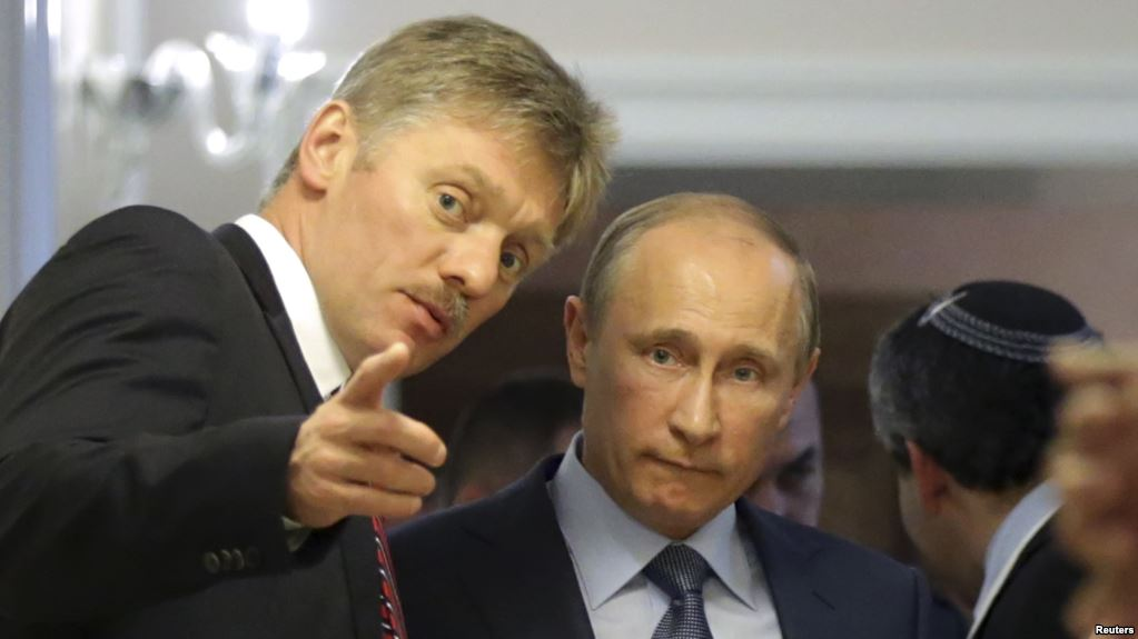 Russian President Vladimir Putin (R) listens to his spokesman Dmitry Peskov prior to a joint news conference with Israeli Prime Minister Benjamin Netanyahu at the Bocharov Ruchei state residence in the Black Sea resort of Sochi, May 14, 2013. Russian President Vladimir Putin said on Tuesday it was important to avoid actions that might aggravate Syria's civil war, a veiled warning against foreign military intervention or arming anti-government forces. REUTERS/Maxim Shipenkov/Pool (RUSSIA - Tags: POLITICS)
