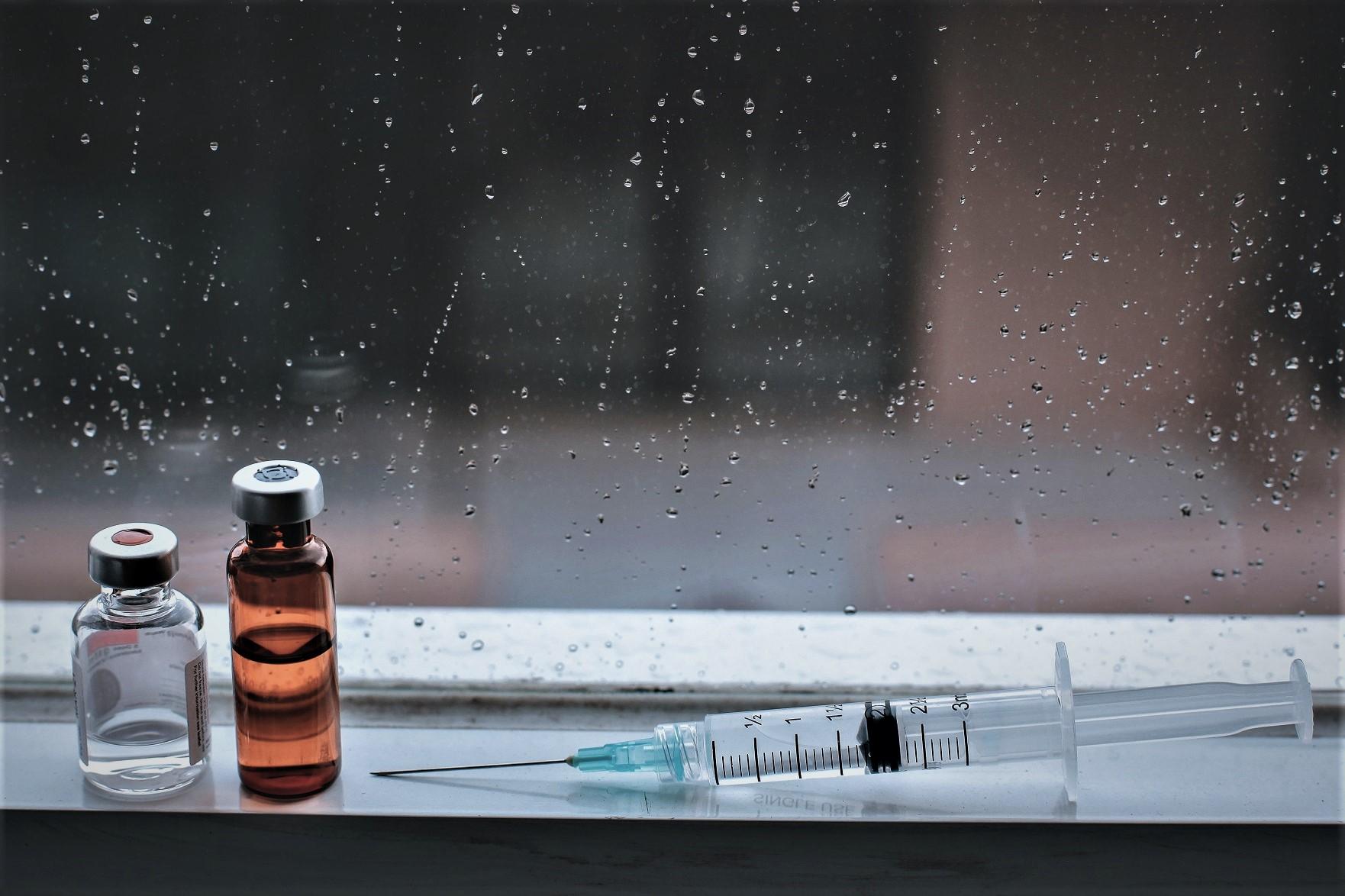 used vaccine bottles and syringe F64D4TF2 NDI NDI